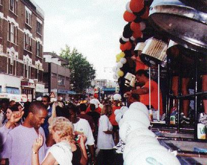 The Real Steel float passing down Ladbroke Grove surrounded by people