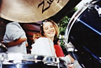 Leanne Bailey drumming and posing at the same time